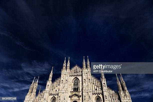 The Milan cathedral on Piazza del Duomo is pictured in the city centre of Milan on September 6 2017 / AFP PHOTO / Marco BERTORELLO