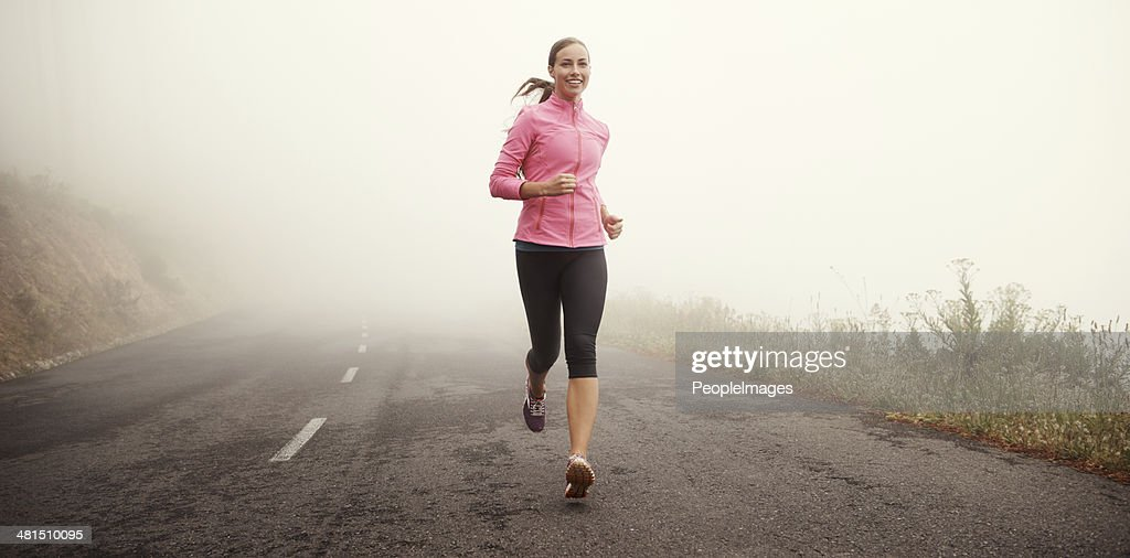 The miles are rolling away behind her : Stock Photo