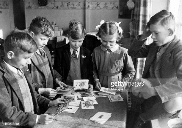 The Miles Quad from St Neots Cambridgeshire England 28th November 1945 Left to Right Michael Paul Ernest and Ann pictured opening cards on their 10th...