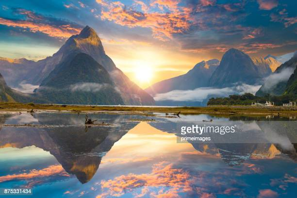 the milford sound fiord. fiordland national park, new zealand - sunset lake stock photos and pictures