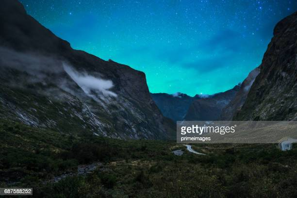 the milford sound fiord. fiordland national park, new zealand with milky way - southland new zealand stock pictures, royalty-free photos & images