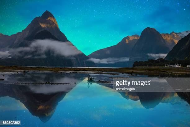 the milford sound fiord. fiordland national park, new zealand with milky way - aurora australis stock pictures, royalty-free photos & images