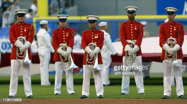 The military band waits to play 15 July 2003 before the 74th midsummer classic at US Cellular Field in Chicago IL The American League beat the...