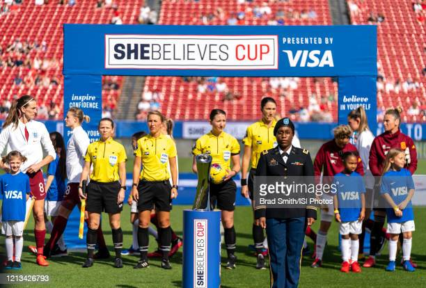 The military escort stands withe SheBelieves Cup trophy during a game between England and Spain at Toyota Stadium on March 11 2020 in Frisco Texas