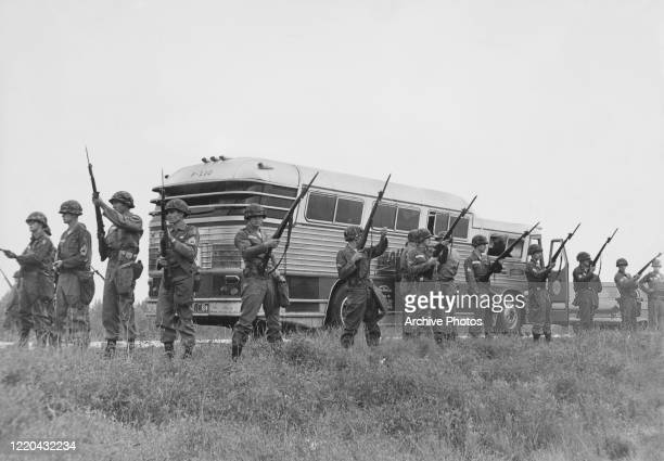 The military guard a bus en route from Montgomery, Alabama, as civil rights activists known as the Freedom Riders head for Jackson, Mississippi, 26th...