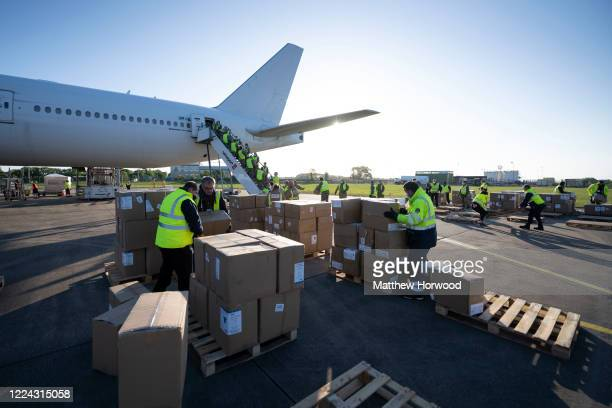 The military help to unload boxes of PPE from a Nordwind Airlines passenger aircraft at Cardiff Airport on May 12 in Cardiff, Wales. The delivery,...