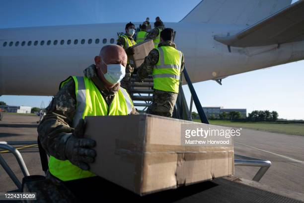 The military help to unload boxes of PPE from a Nordwind Airlines passenger aircraft at Cardiff Airport on May 12 in Cardiff Wales The delivery from...