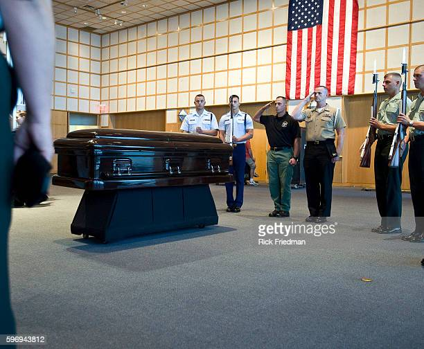 The military honor guard preparing for the arrival of the body of Senator Edward M Kennedy at the John F Kennedy Library in the Dorchester section of...