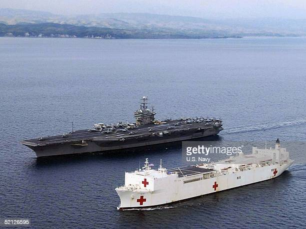 The Military Sealift Command hospital ship USNS Mercy is seen alongside USS Abraham Lincoln after arriving February 3 2005 near Banda Aceh Sumamtra...