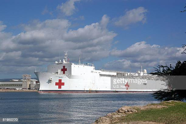 The Military Sealift Command hospital ship USNS Mercy is shown moored in Pearl Harbor for a brief port visit before deploying to support Operation...