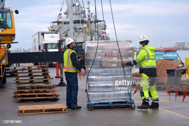The Military Sealift Command hospital ship USNS Mercy takes on supplies March 20 at Naval Base San Diego Calif in preparation to support the nations...