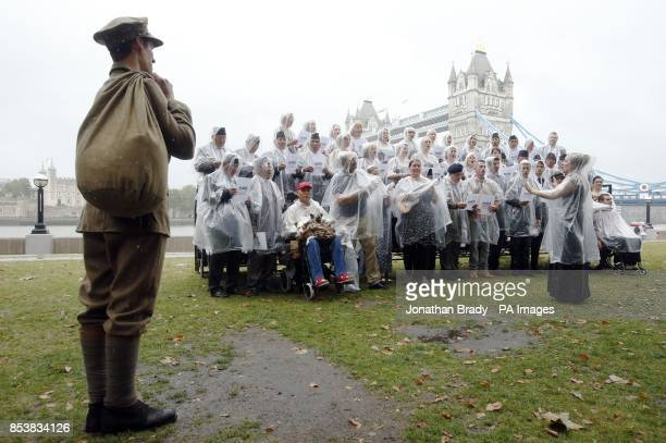 The Military Wives choir along with other SSAFA beneficiaries brave the rain during a launch event for their new recording of 'Pack Up Your Troubles'...