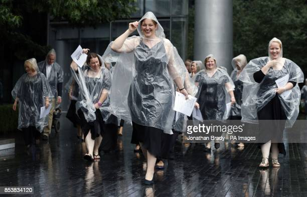 The Military Wives choir brave the rain en route to a launch event for their new recording of 'Pack Up Your Troubles' proceeds of which will benefit...
