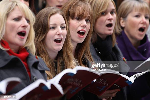 The military wives choir sing outside Number 10 Downing Street ahead of a reception with British Prime Minister David Cameron for returning British...