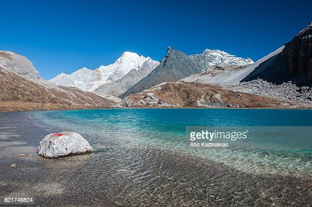 The milk lake at 4600m above sea level with Mt Xianuo Duoji one of 3 holy mountains of Yading Nature Reserve Yading is located in southern Daocheng...