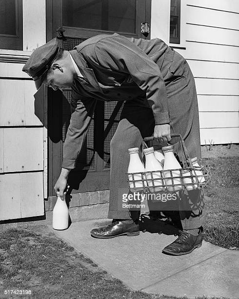 The milkman leaving milk on the doorstep Model WT Donnelly Undated photograph