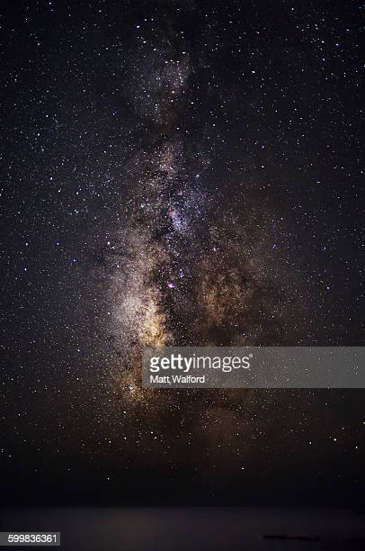 the milky way above ocean, crete, greece - nebula stock pictures, royalty-free photos & images