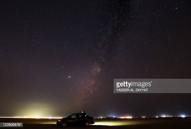 The Milky Way galaxy is pictured on October 13, 2020 in Kuwait's Mutriba desert, 100 kms northwest of the capital Kuwait City.