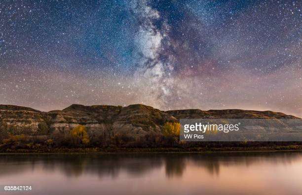 The Milky Way in Sagittarius going down behind the badland hills along the Red Deer River I shot this near East Coulee on Highway 10 in Alberta on an...