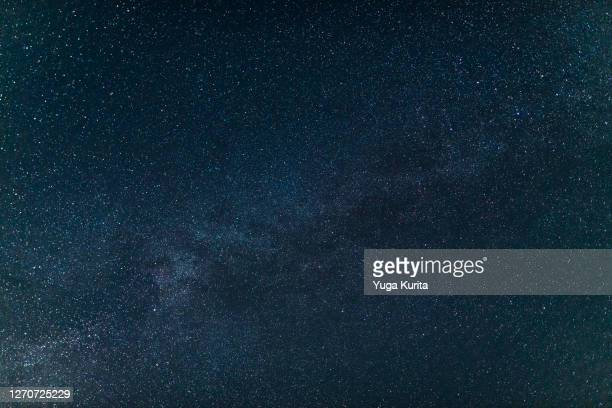 the milky way in the night sky - navy blue stock pictures, royalty-free photos & images