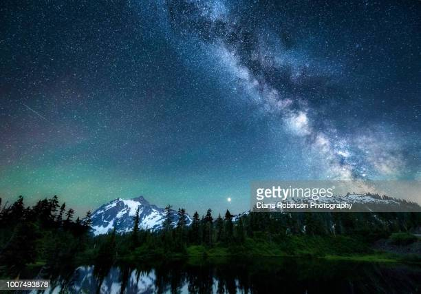 the milky way, meteors and northern lights above mount shuksan reflected in highwood lake, mount baker-snoqualmie national forest, washington state - cascade range stock pictures, royalty-free photos & images