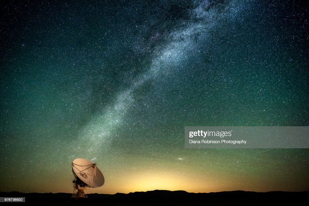 The Milky Way over a radio telescope at the Karl G. Jansky Very Large Array National Radio Astronomy Observatory in New Mexico : Stock Photo