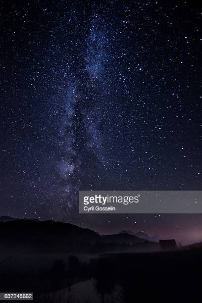 the milky way over gerold lake - mittenwald stock pictures, royalty-free photos & images