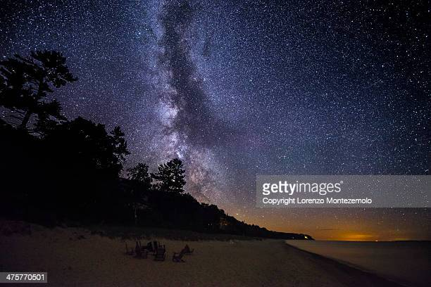the milky way over the lake | leland, michigan - lake michigan stock pictures, royalty-free photos & images