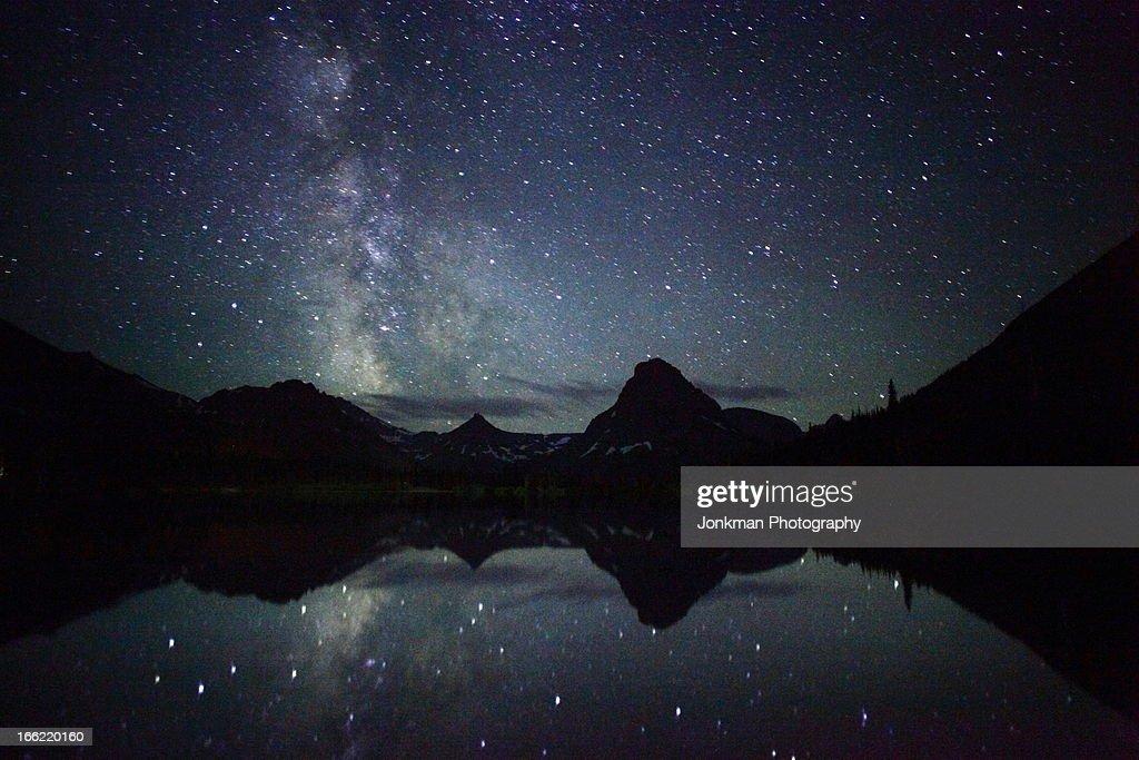 The Milky Way Reflecting at Glacier NP : Foto de stock