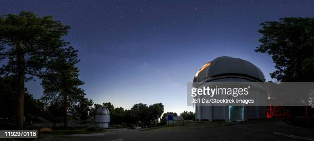 the milky way rises above the city lights of los angeles at mount wilson observatory, california, usa. - observatory stock pictures, royalty-free photos & images
