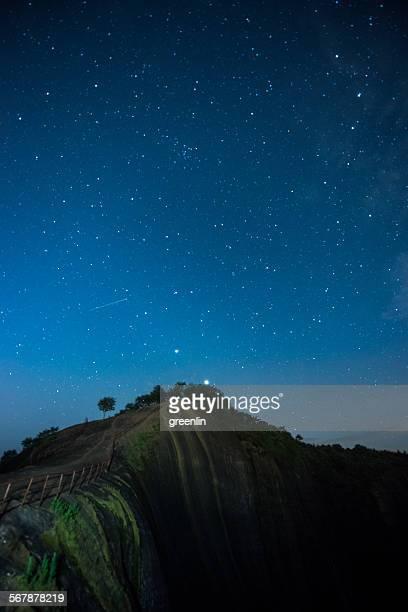 The Milky Way shines over the danxia mountain rang