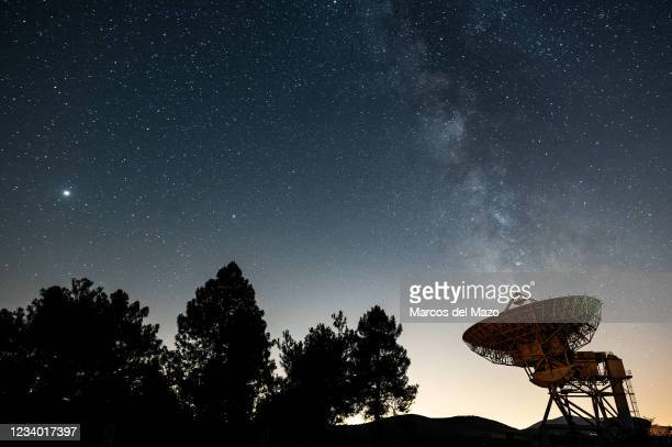 The Milky Way with Jupiter and Saturn , rising over a large dish of the Satellite Communications Center of Buitrago de Lozoya, north of Madrid. The...