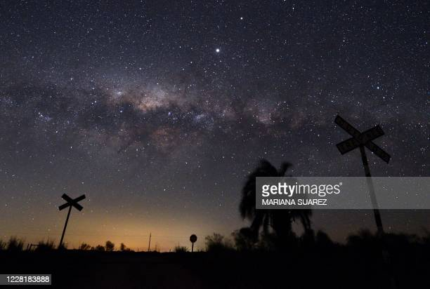 The Milky Way's Galactic Centre and Jupiter are seen from the countryside near the small town of Reboledo, department of Florida, Uruguay, early on...