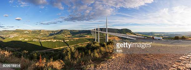 The Millau Viaduct (French: le Viaduc de Millau) - Panorama with Millau town at sunset