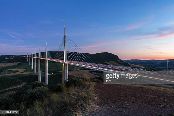 The Millau Viaduct (France) with lighttrails at sunset