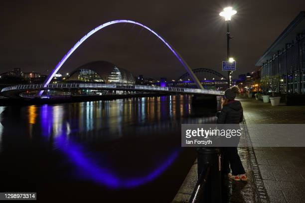 The Millennium Bridge in Newcastle is bathed in purple light to commemorate Holocaust Memorial Day on January 27, 2021 in Newcastle upon Tyne,...
