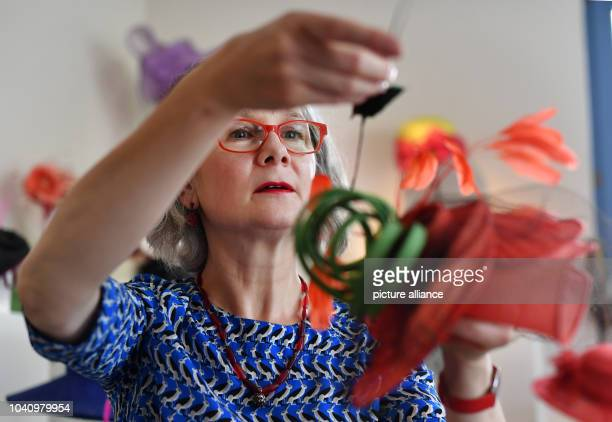 The Milliner Jacqueline Peevski posing in her studio with her hat creations in Dresden, Germany, 29 July 2016. Sometimes she produces hats for...