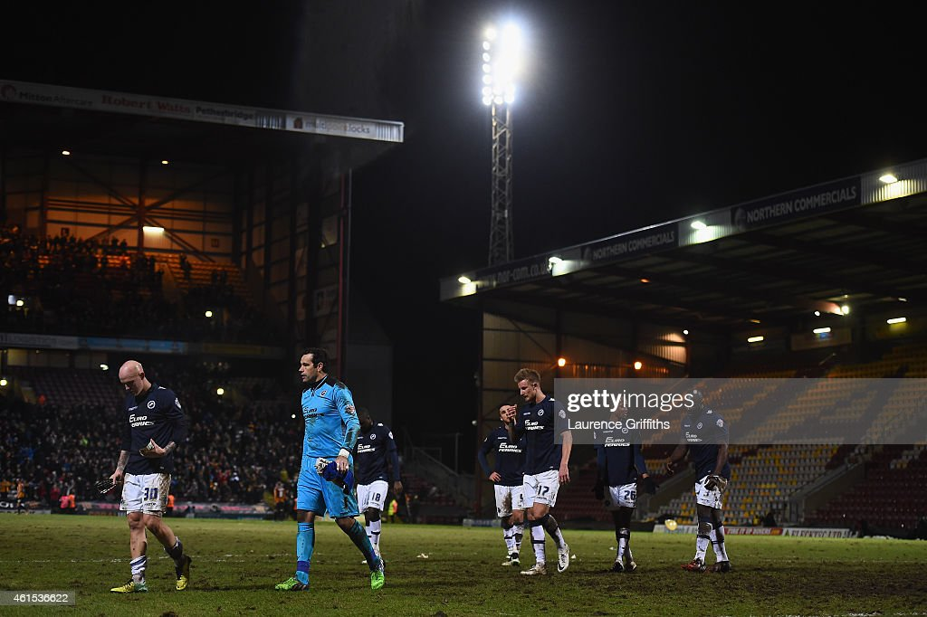 The Millwall team trudge off the field after defeat in the FA Cup Third Round Replay between Bradford City and Millwall at Coral Windows Stadium, Valley Parade on January 14, 2015 in Bradford, England.