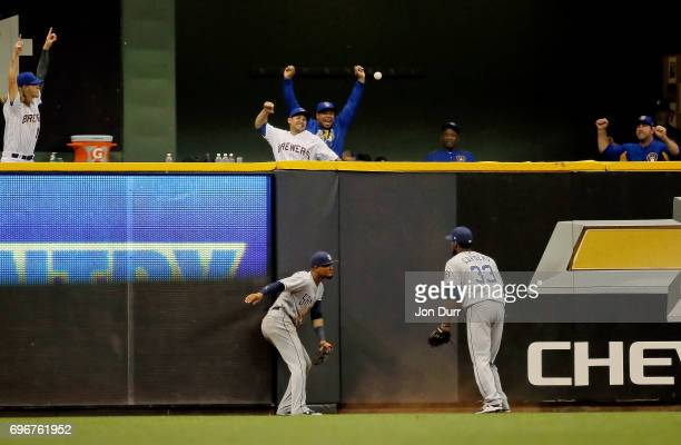 The Milwaukee Brewers bullpen celebrates after Allen Cordoba of the San Diego Padres is unable to catch the walkoff homerun ball of Eric Thames of...