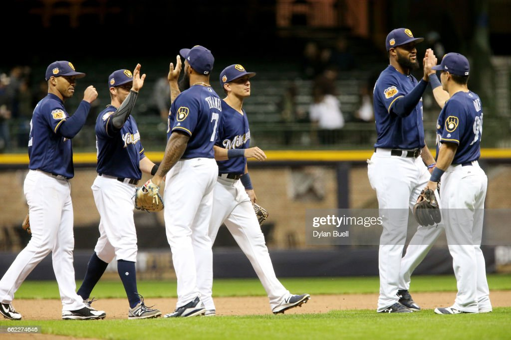 The Milwaukee Brewers celebrate after beating the Chicago White Sox 5-2 during an exhibition game at Miller Park on March 31, 2017 in Milwaukee, Wisconsin.