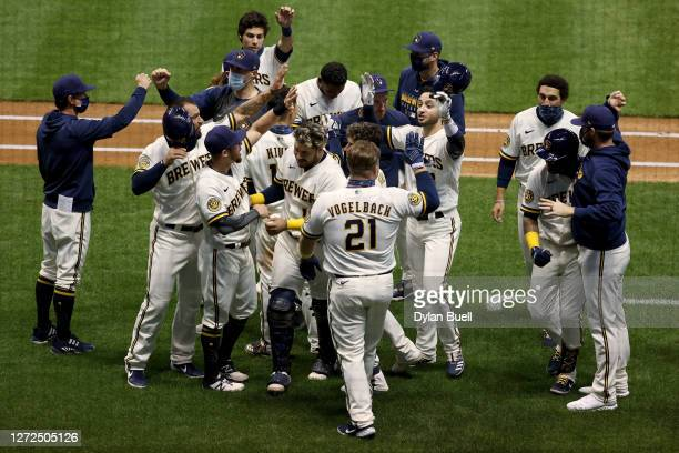 The Milwaukee Brewers celebrate after beating the St. Louis Cardinals 2-1 in eight innings in game one of a doubleheader at Miller Park on September...