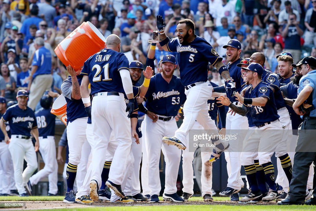 The Milwaukee Brewers celebrate after Travis Shaw #21 hit a walk off home run to beat the Chicago Cubs 4-3 in 10 innings at Miller Park on September 23, 2017 in Milwaukee, Wisconsin.