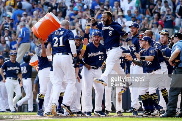 The Milwaukee Brewers celebrate after Travis Shaw hit a walk off home run to beat the Chicago Cubs 43 in 10 innings at Miller Park on September 23...
