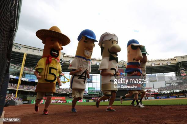 The Milwaukee Brewers racing sausages entertain fans during a game between the Milwaukee Brewers and the San Diego Padres on June 18th 2017 at Miller...
