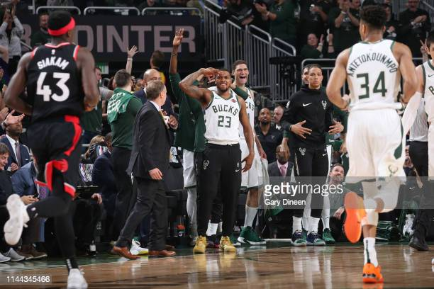 The Milwaukee Bucks bench celebrates a made three point basket during Game Two of the Eastern Conference Finals on May 17 2019 at the Fiserv Forum in...