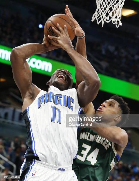 The Milwaukee Bucks' Giannis Antetokounmpo blocks a shot by the Orlando Magic's Bismack Biyombo at the Amway Center in Orlando Fla on Wednesday March...