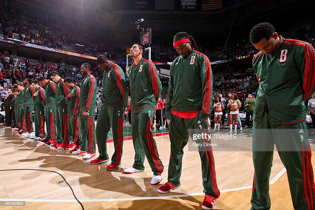 The Milwaukee Bucks listen to the National Anthem before playing against the Miami Heat in Game Three of the Eastern Conference Quarterfinals during the 2013 NBA Playoffs on April 25, 2013 at the BMO Harris Bradley Center in Milwaukee, Wisconsin.