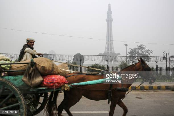 The MinarePakistan public monument stands shrouded in smog in Lahore Pakistan on Tuesday Nov 14 2017 The fates of 15 billion people in both India and...