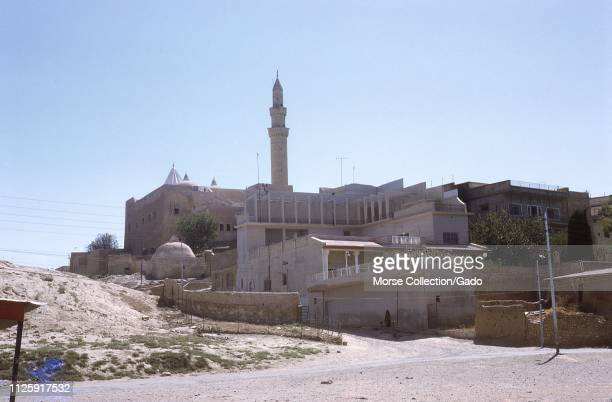 The minaret and shrine of the Nebi Yunus Mosque of the Prophet Jonah in Mosul, Iraq, August, 1971. The Sunni religious complex was demolished by ISIS...