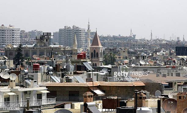 The minarets of mosques and the steeples of churches are seen towering above rooftops in the Syrian capital Damascus on June 26 2013 AFP PHOTO /...